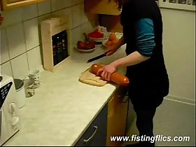 Slutty wife fucks a giant meat sausage in the kitchen